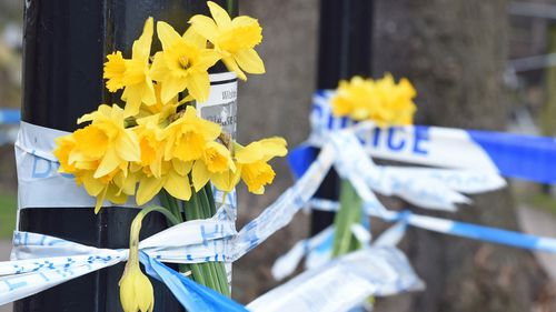 Flowers at the spot in Salisbury  where the former double agent and his daughter were found seriously ill on a bench
