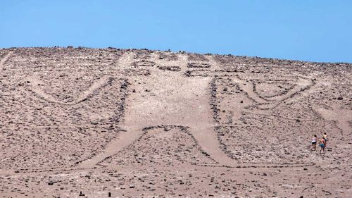 The Atacama Giant is a millennium-old, but was damaged by Belgian tourists.