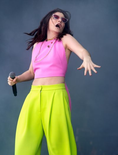 Lorde in a neon departure from black at BBC Radio's Big Weekend Day in the UK, May.