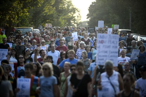 Hundreds walked from the site of Justine's fatal shooting to Plaissance Park in the suburb of Beard, Minneapolis. Picture: AAP