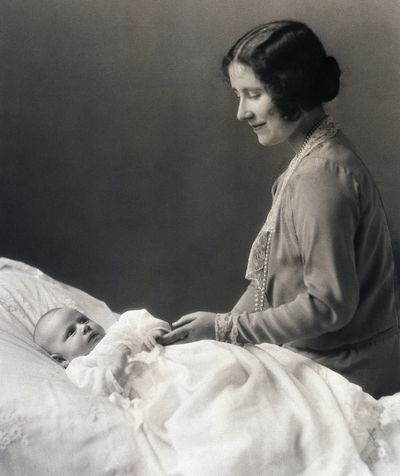 Then: The late Queen Mother Elizabeth (then The Duchess of York) with herinfant daughter, Princess Margaret Rose in 1930.