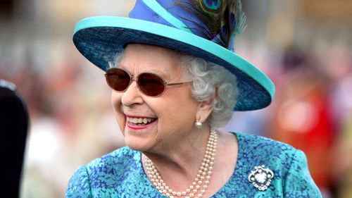 The palace made the announcement yesterday after the queen was seen wearing sunglasses at a number of recent public engagements. Picture: AP