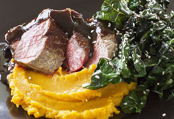 Beef fillet with orange miso sauce, sesame kale and sweet potato mash