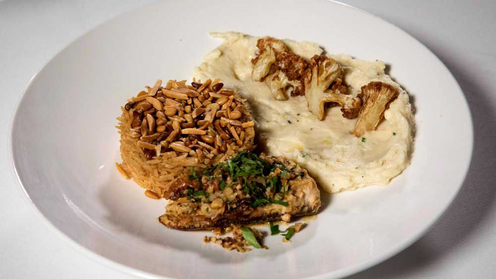 The Sharouk's tahini baked samka hara fish, sayidiya rice, cauliflower and potato mash with fried cauliflower