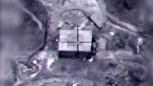 A framegrab made from a handout video made available by the Israeli Defense Forces (IDF) on 21 March 2018 shows an alleged reactor building being targeted by Israeli Air Force. (IDF)