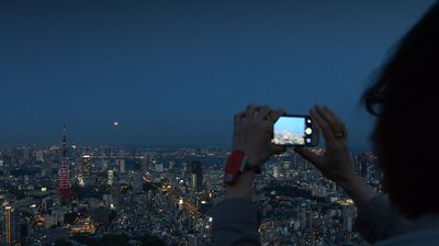 A Tokyo resident captures the moment on a smarthphone.