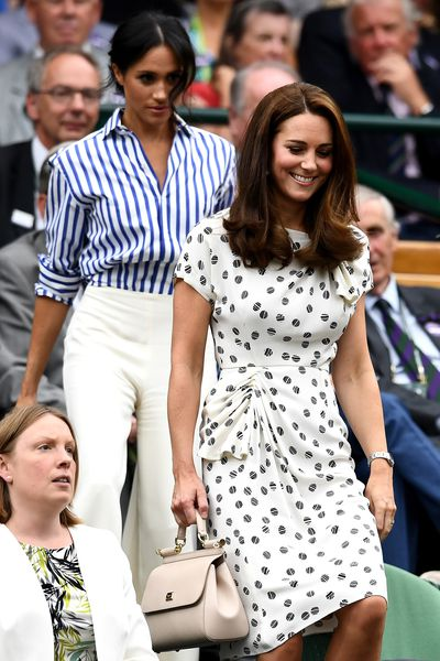 The Duchess of Cambridge Kate Middleton with sister-in-law Meghan Markledruing day twelve of the Wimbledon Lawn Tennis Championships at All England Lawn Tennis and Croquet Club in London, England, July, 2018.