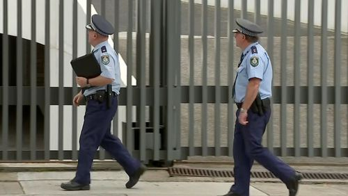 NSW Police at the Sydney home of Don Harwin this afternoon.
