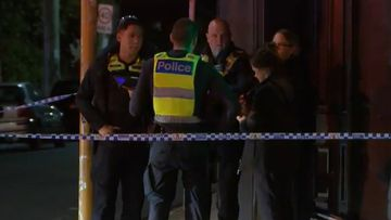 Police set up a crime scene at the site of a stabbing in Melbourne.