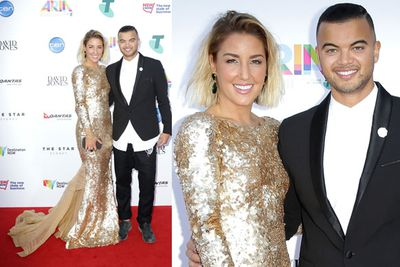 Guy Sebastian trying not to trip over his wife Jules' epic dress trail.