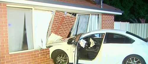A man was woken up by a car crashing into his home.