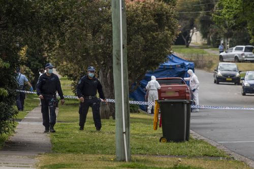 Police investigators working with blue tent and police tape after an 18-year-old man was stabbed in Blacktown last night.