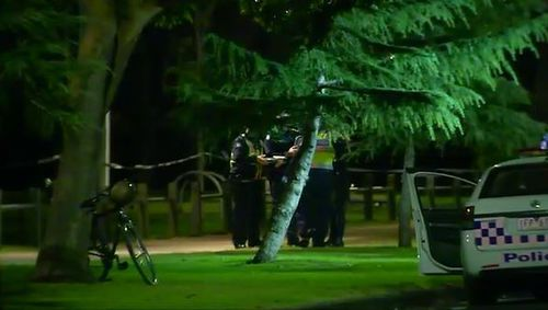 Police have locked down the park in Carlton North after the woman's body was found. Picture: 9NEWS
