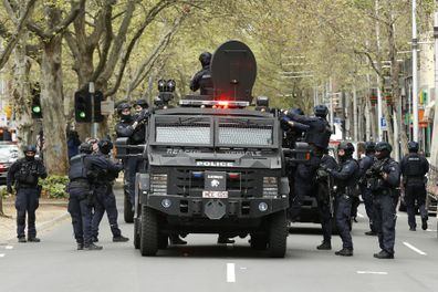 MELBOURNE, AUSTRALIA - SEPTEMBER 22: The Critical Incident Response Team (CIRT) of the Victorian Police are seen along King Street on September 22, 2021 in Melbourne, Australia. Protests started on Monday over new COVID-19 vaccine requirements for construction workers but  turned into larger and at times violent demonstrations against lockdown restrictions in general. Melbourne is currently subject to COVID-19 lockdown restrictions, with people only permitted to leave home for essential reasons.