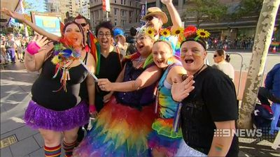 Mardi Gras goers have no trouble getting into the spirit. (9NEWS)