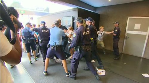 Students clashed with police as they tried to force their way into the venue. (9NEWS)