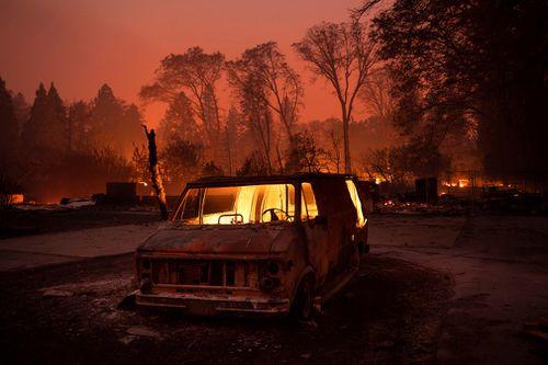 Flames burn inside a van in Paradise.