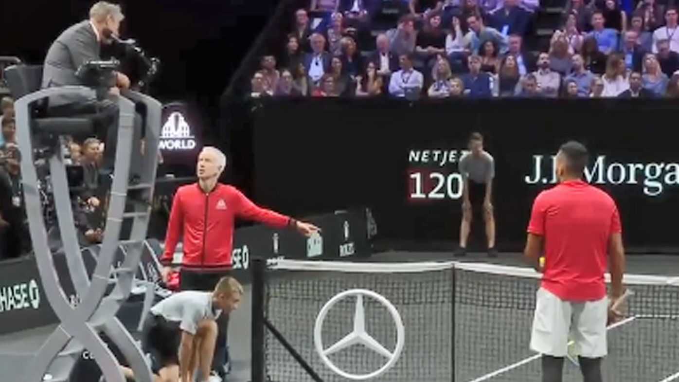 John McEnroe and NIck Kyrgios argue with the chair umpire
