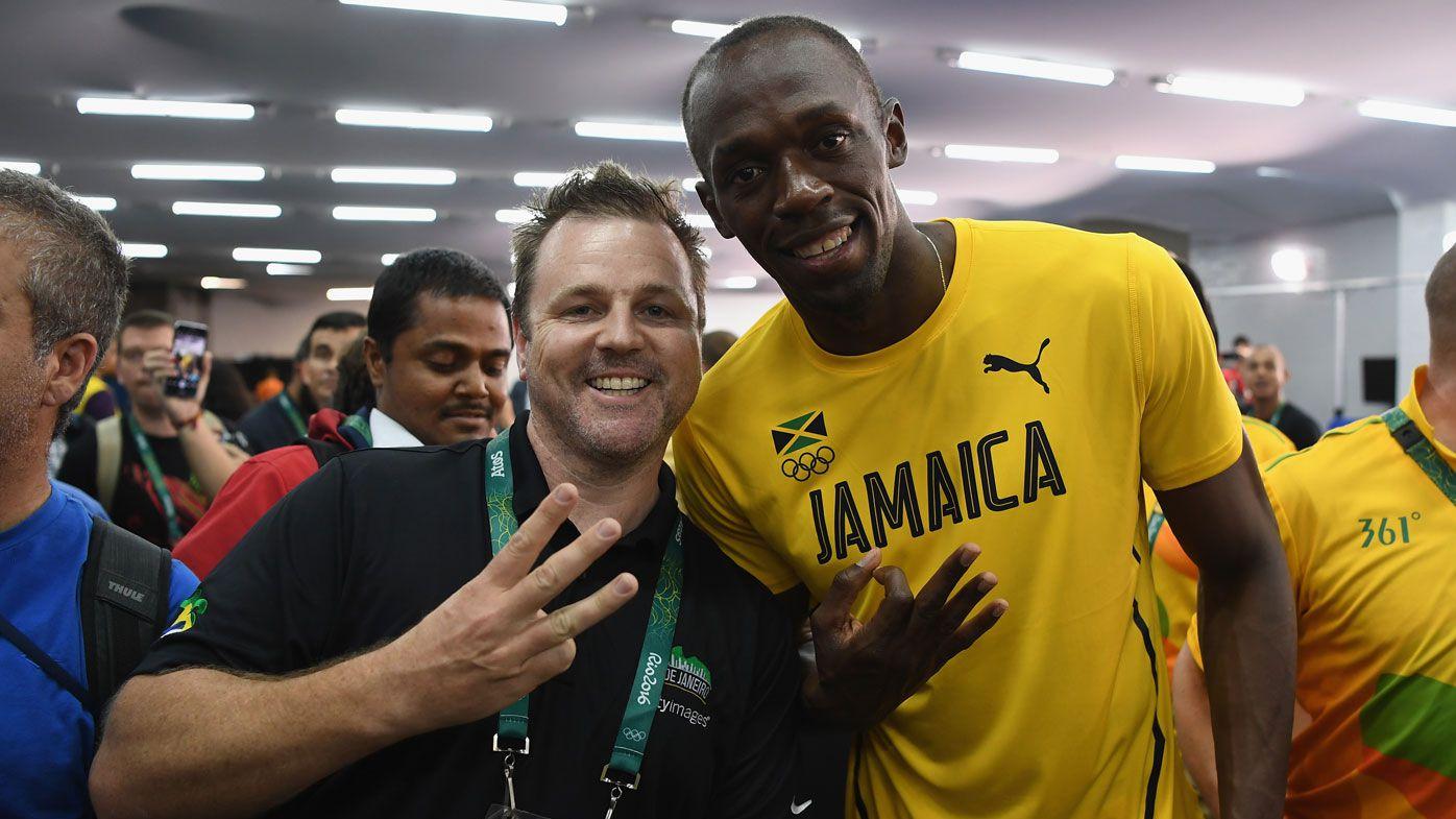 Getty photographer Cameron Spencer with Usain Bolt.