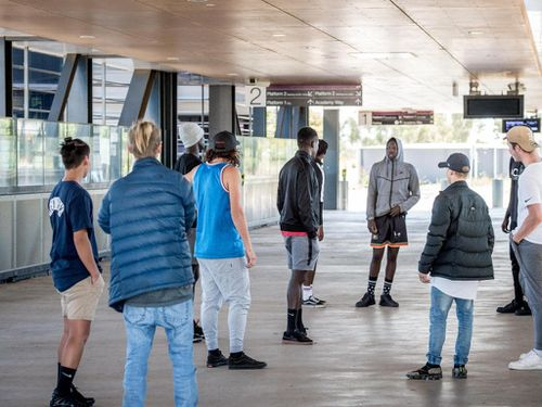 Two groups of teens argue at Wyndham Vale station.