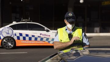 Police check drivers on Enmore Road as part of the enforcement of Public Health orders in Sydney.