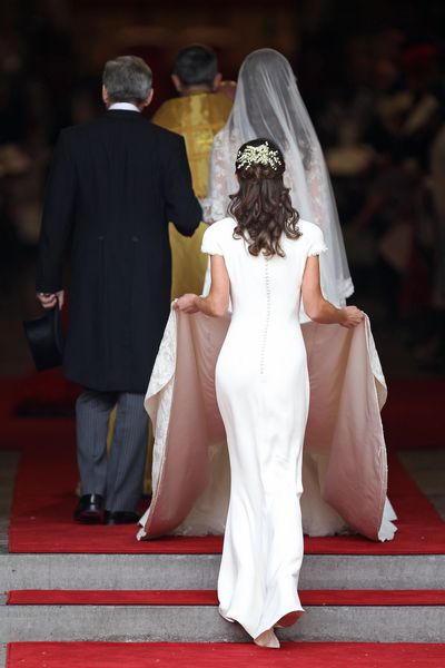 Pippa Middleton holds the train of her sister Kate Middleton's wedding dress.