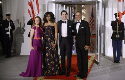 <p>In Canada in 2016 Michelle Obama mixed things up by opting for a strapless black gown with a floral motif by Canadian designer Jason Wu.</p> <p>Image: Getty.</p> <p>&nbsp;</p>
