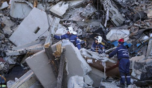 Emergency Situations employees working at the scene of a collapsed apartment building in Magnitogorsk