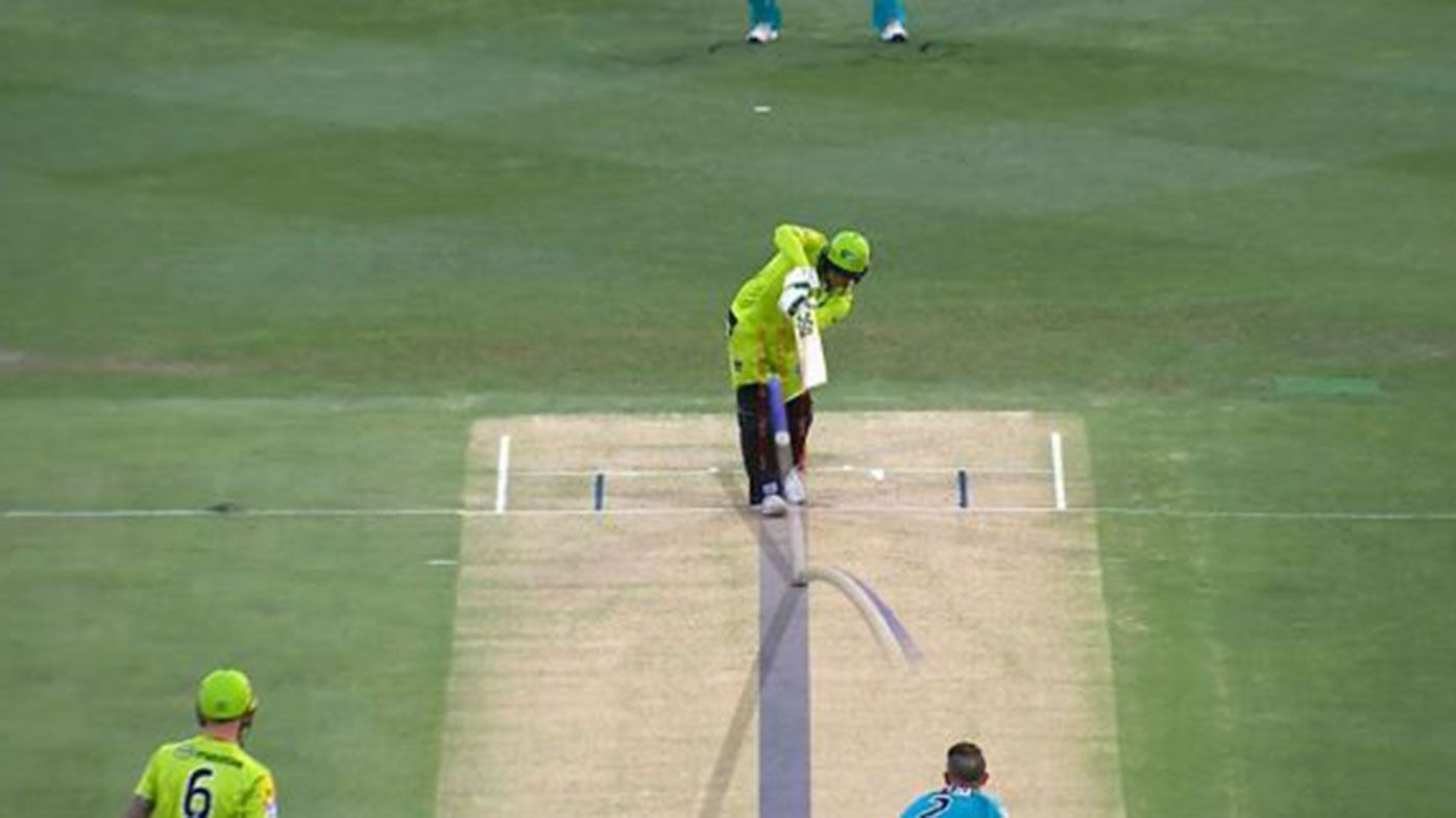Usman Khawaja survived this LBW call in the BBL opener.