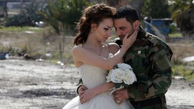 "<p>Hassan Youssef, 27, clad in his military camouflage and Nada Merhi, 18, dressed in a traditional white wedding gown, stood amid the rubble of the city for a series of wedding photographs by Jafar Meray, who wanted ""to show that life is stronger than death"". </p><p>(Joseph Eid/AFP/Getty)</p>"