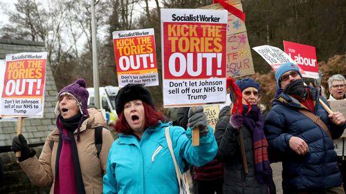 Protesters demonstrate outside John Smedley Mill ahead of UK Prime Minister Boris Johnson's arrival on December 05, 2019 in Matlock, England.
