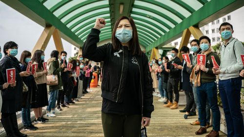 Medical workers hold a strike near Queen Mary Hospital to demand the government shut the city's border with China to reduce the spread of the coronavirus.