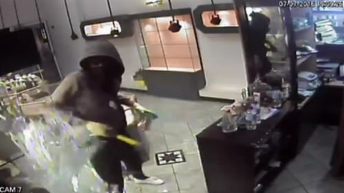 CCTV captured Mawien robbing a jewellery store. (9NEWS)