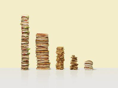 Piles of food including hamburgers