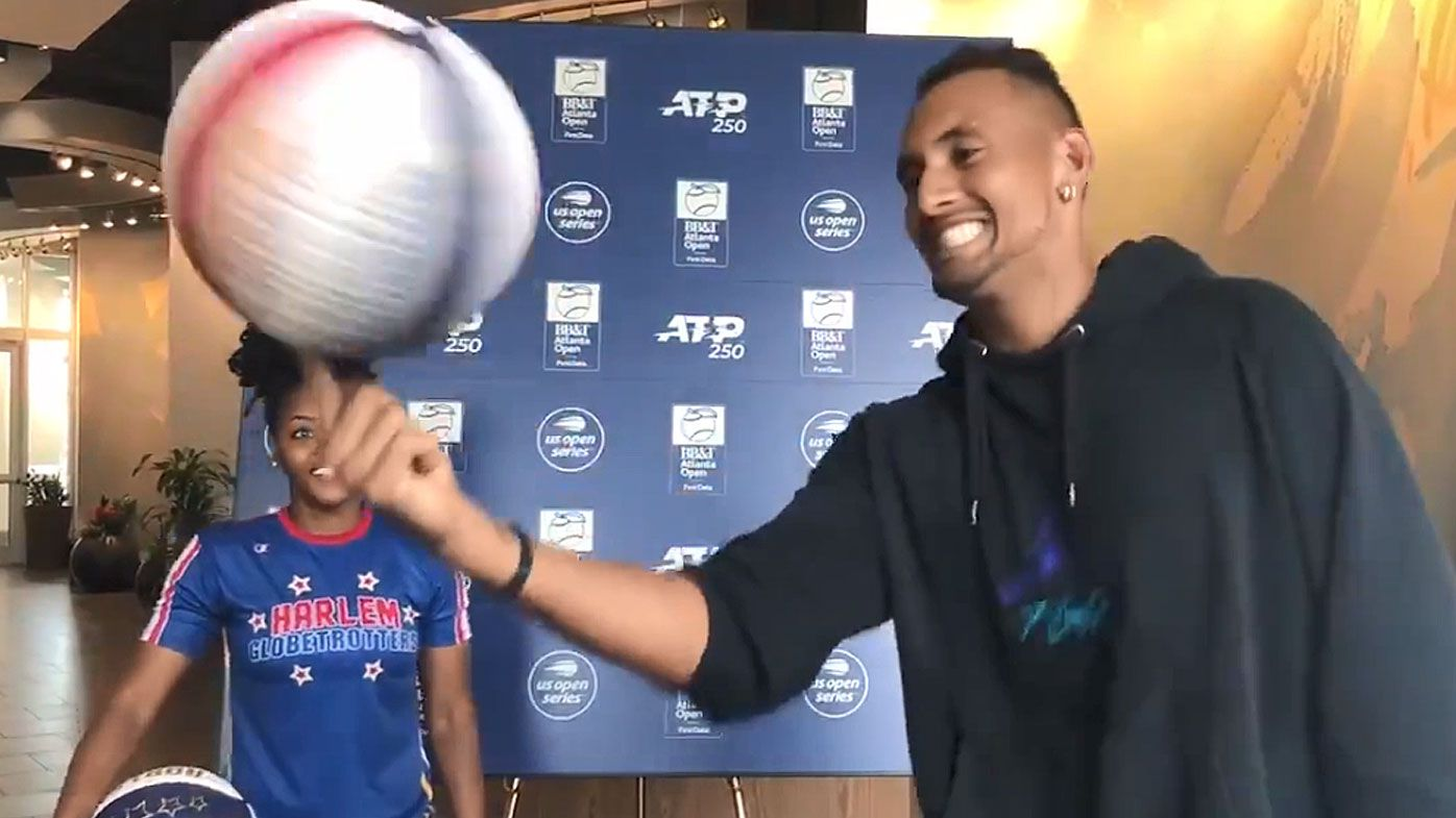 Nick Kyrgios tests his basketball skills