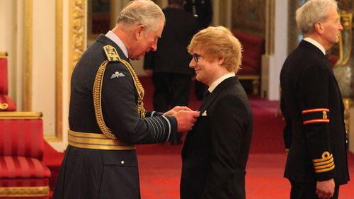 The singer received the accolade for his services to music and charity. (Press Association)