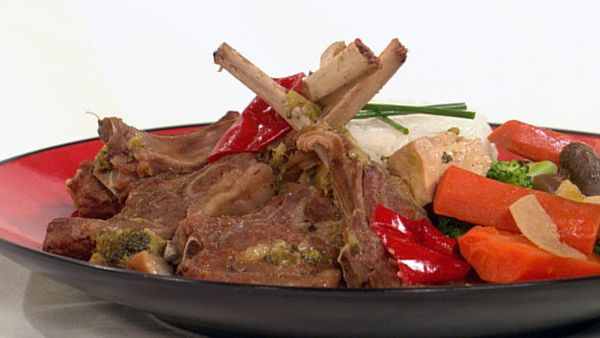 Braised lamb cutlets with vegetables on a timbale of rice
