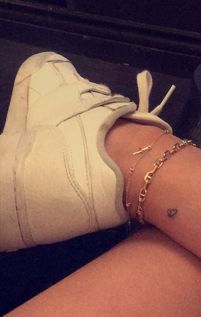 Kylie Jenner, Travis Scott, matching tattoo, ankle, butterfly