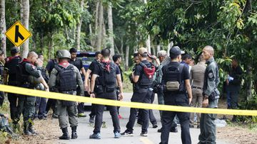 Gunmen fired at security personnel at checkpoints in Thailand's insurgency-wracked south, killing 14 volunteer officers and wounding five others, police said Wednesday. (AP Photo/Sumeth Panpetch)