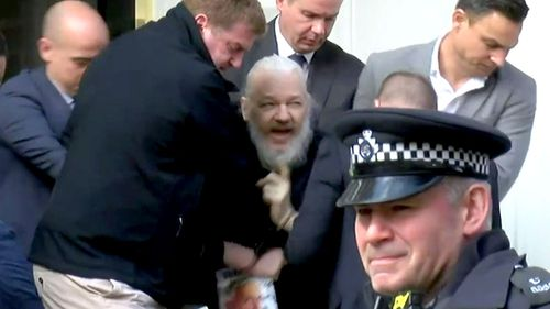 WikiLeaks founder Julian Assange is dragged out of the Ecuadorian embassy.
