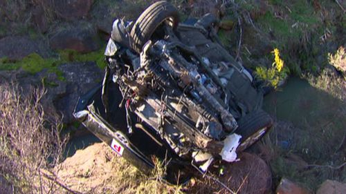 Ms Bautista's car wreck at the bottom of the embankment. (9NEWS)