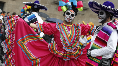 Performers in costume attend a Day of the Dead parade in Mexico City, Sunday, Oct. 27, 2019