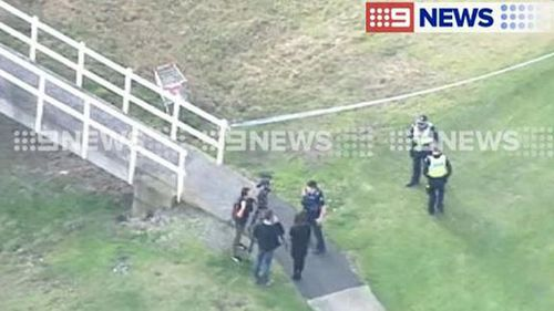Police speak with possible witnesses following the stabbing. (9NEWS)