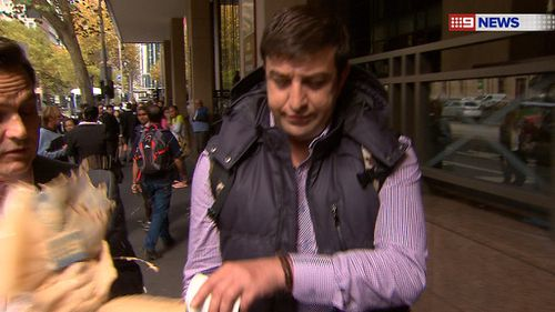 Taha removed the lid from his coffee before throwing it at Raskall. (9NEWS)