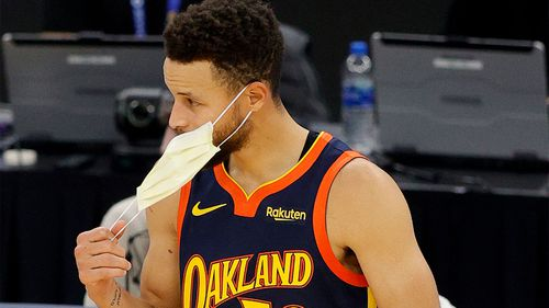 Mask use is mandatory in California with very little exceptions. In this photo, basketballer Steph Curry removes his mask before a game.