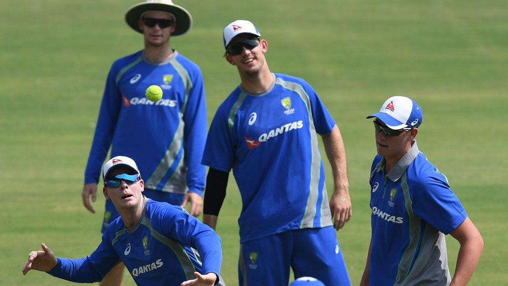 Peter Handscomb (l), Steve Smith (c), Mitchell Marsh (c) and Mitchell Swepson.
