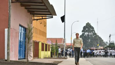 Prince Harry walking the same part of Huambo, September 2019