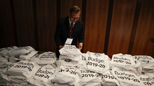 The budget papers are stacked in bundles for journalists ahead of the budget lock-up.