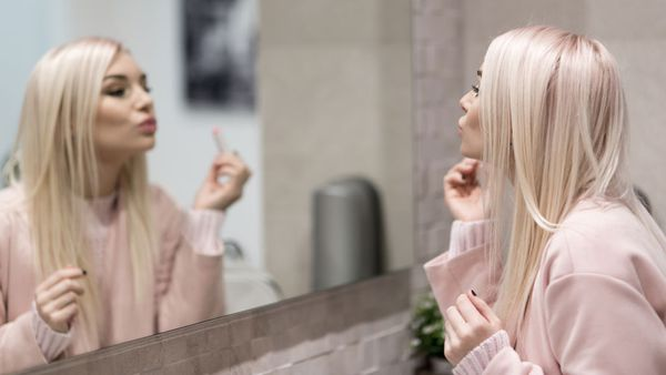 Woman looking into the mirror, narcissist