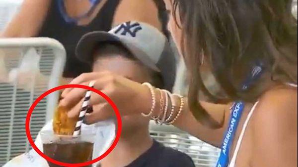 Woman dips chicken finger into soda beverage